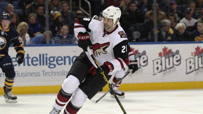 Arizona Coyotes left wing John Scott (28) looks for the puck during the first period against the Buffalo Sabres at First Niagara Center.