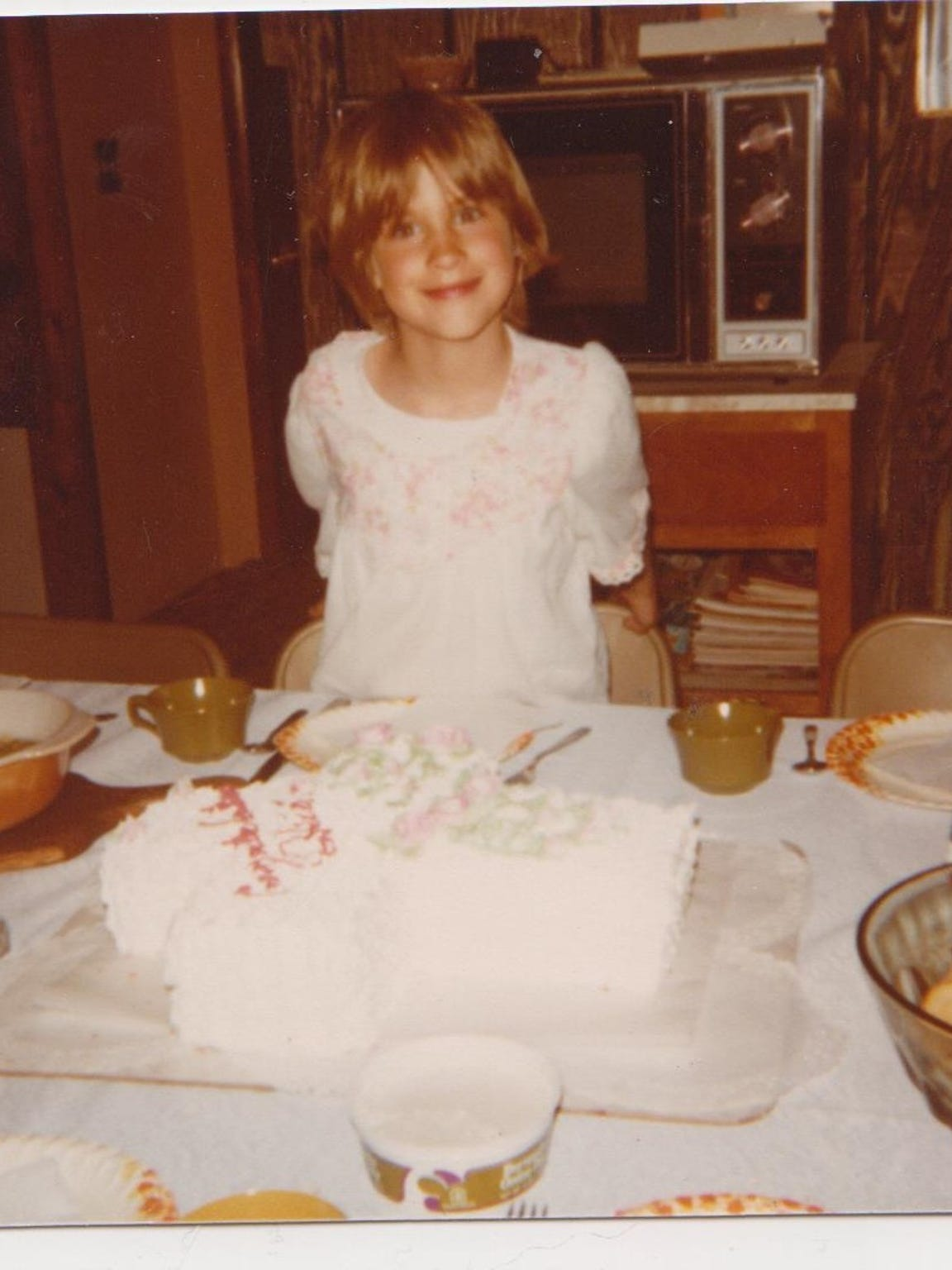Heidi Wolfe, as a child, posing for a photo. Year unknown.