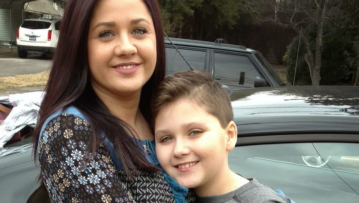 Adrienne Eggers, 29, with her son Maddox, 10. The photo