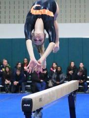 Northville's Erin McCallum goes through her balance