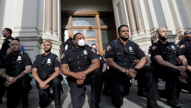 Thousands of people erupted in cheers as members of the Jersey City Police Department took a knee to remember George Floyd. Tuesday, June 2, 2020