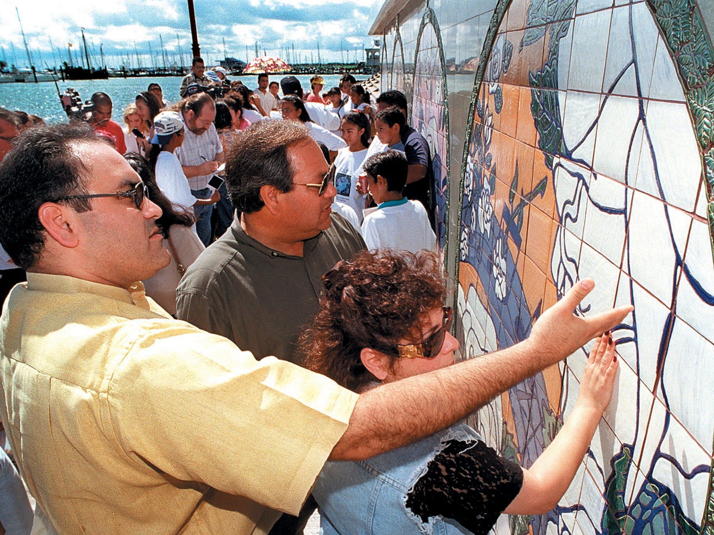 Bert Quintanilla, left, Abraham Quintanilla, center,