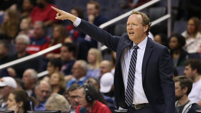 Apr 6, 2018; Washington, DC, USA; Atlanta Hawks head coach Mike Budenholzer gestures from the bench against the Washington Wizards in the first quarter at Capital One Arena. The Hawks won 103-97.