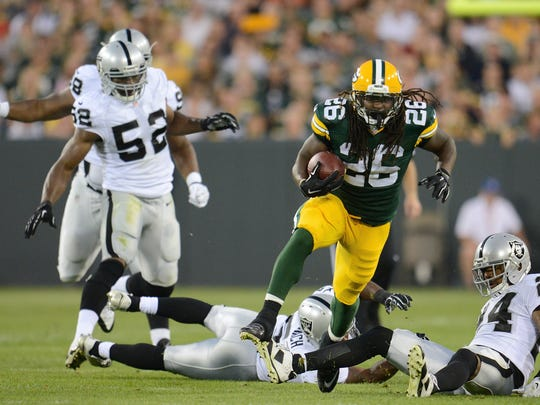 Green Bay Packers running back DuJuan Harris (26) finds space in the first half. The Green Bay Packers hosted the Oakland Raiders in an exhibition game at Lambeau Field in Green Bay, Wis. on Friday, Aug. 22, 2014. Kyle Bursaw / Press-Gazette Media