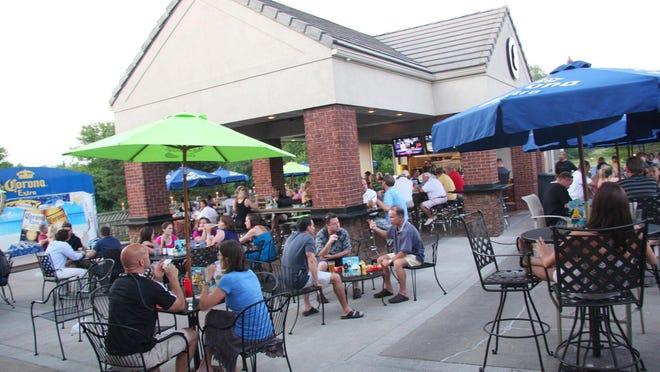 Patrons enjoy drinks at Saints Pub & Patio in West Des Moines.