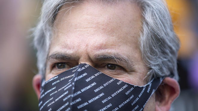 Austin Mayor Steve Adler, seen here at a police protest on June 7, joined mayors from eight other Texas cities in asking Gov. Greg Abbott to allow local governments to enforce their facial covering rules.