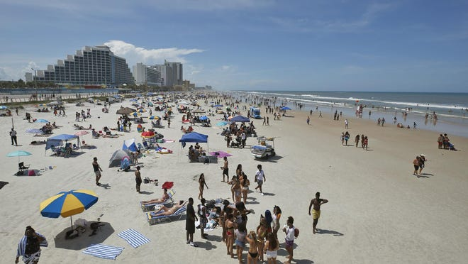 Crowds take to the beach earlier this summer in Daytona Beach. Although declines in bed tax collections have eased since the height of the pandemic-related tourism downturn, hoteliers say another challenge awaits after the summer beach season ends.