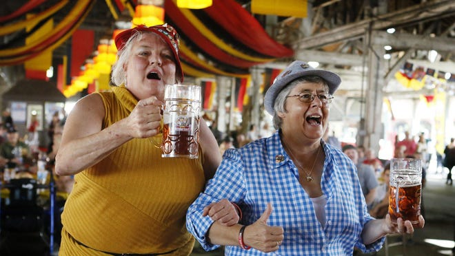 Debbie Zimmer, left, and Ann Monkelban, both of Cincinnati, sing during Oktoberfest at the Ohio Expo Center in 2019.