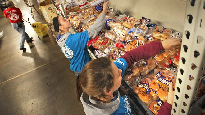 Visiting FFA members volunteer at the St. Vincent de Paul food pantry warehouse, 3001 E. 30th St. The pantry is one of the largest in the Midwest, serving thousands of people every week.
