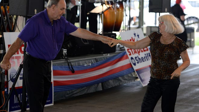 Tommy and Laural Hardin dance to the music of Magi during a campaign kick-off concert for Madison County sheriff candidate Rick Staples on Friday at the West Tennessee Farmers Market in Downtown Jackson.