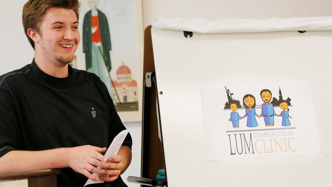 Devon Wolfe, a senior at Jefferson High School, on Tuesday discusses what inspired the logo he designed for Lafayette Urban Ministry's immigration services clinic.