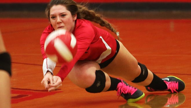 Kaylie Edgar stretches out for the ball as Palm Springs defeats Walnut in their opening CIF volleyball playoff match, Tuesday, November 11, 2014