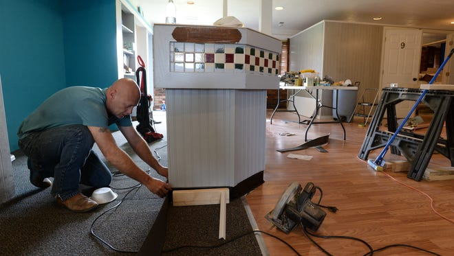 Rod Vaughn works inside the former Pizza Hut building on National Road West in Richmond. The building is being turned into Beach Head Tanning.