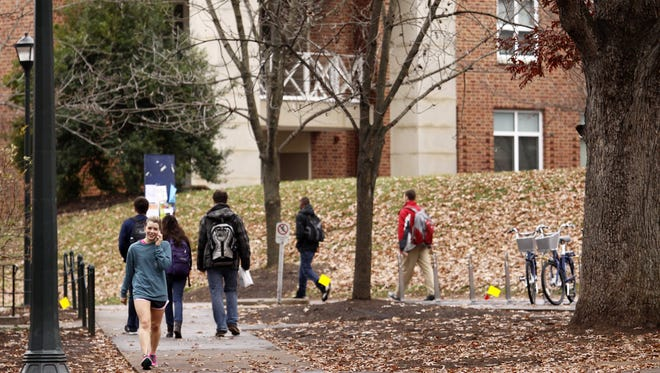 Students walk through the University of Virginia campus.