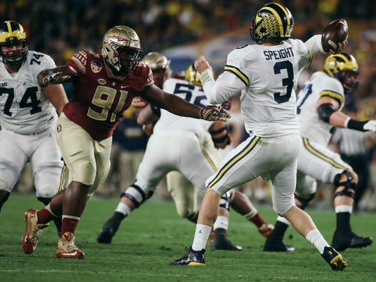Derrick Nnadi (91) pressures Michigan quarterback Wilton Speight (3) during the first half of the Orange Bowl on Friday, December 30, 2016. The Seminoles topped the Michigan Wolverines 33-32.