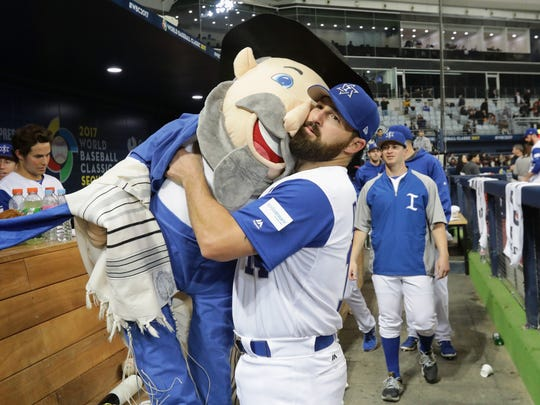 Infielder Cody Decker of Israel holds team mascot, The Mensch, after the World Baseball Classic Pool A Game Five between Netherlands and Israel at Gocheok Sky Dome in Seoul, South Korea.