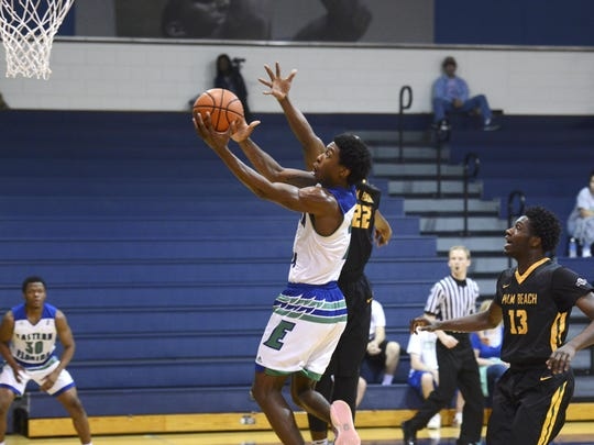 Eastern Florida guard Kareem Brewton scores during Saturday's game against Palm Beach State.