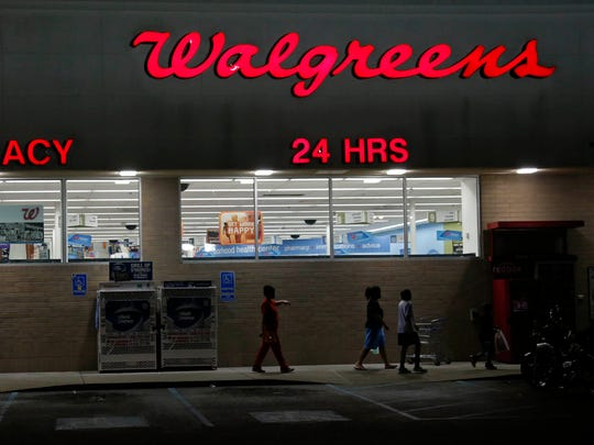 Customers leave a Walgreens pharmacy in Jackson, Miss., in June 2013.