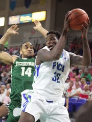 FGCU's Antravious Simmons snatches the rebound under the defense of Jacksonville's Josh Adeyeye during a game at Alico Arena on Wednesday night.