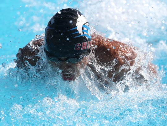 Ryland Sun of Chiles swims the 100m butterfly during