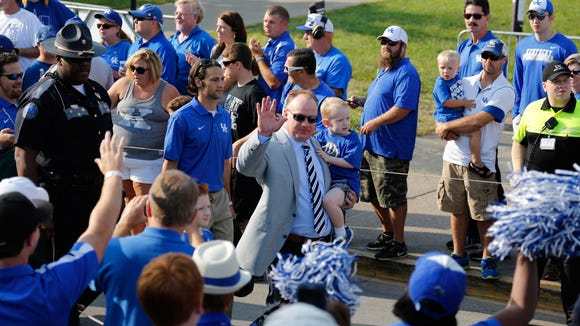 """UK head coach Mark Stoops waves to fans during the """"Cat Walk"""" before last weekend's opener against UT Martin."""