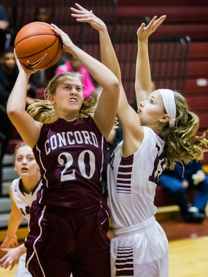 Concord's Caroline Procak (20) puts up a shot under pressure from Caravel's Grace Lange on Dec. 21. The Raiders have won eight of their eight games by at least 11 points.