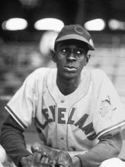"Satchel Paige's best years were behind him when he joined the Cleveland Indians in 1948. Paige appears pensive as he was photographed by George Brace, a Chicago photographer who specialized in baseball. The picture is from a book of Brace's pictures, ""The Game That Was."" (AP Photo/George Brace)"
