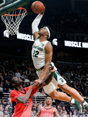 Spartans forward Miles Bridges (22) dunks over Rutgers guard Issa Thiam (35) during the Big Ten basketball matchup between Rutgers and Michigan State at the Breslin Center Wed,  Jan. 4, 2017 in East Lansing. Bridges  finished with six points and six rebounds.