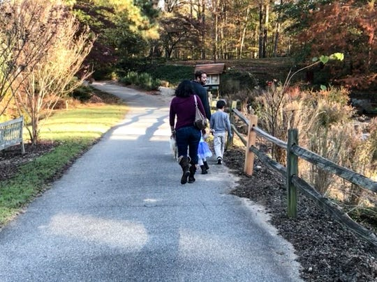 Stella Grove, left, walks with Jake, Scarlett, and Jackson Grove at the South Carolina Botanical Garden in Clemson on Thursday.