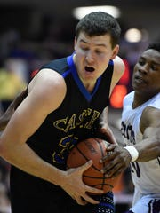 Castle's Payton Mills drives past defense from Ben Davis' Jalen Newson as Castle plays Ben Davis in the Boys' Semi-State Basketball Tourney at Seymour High School Saturday, March 18, 2017.