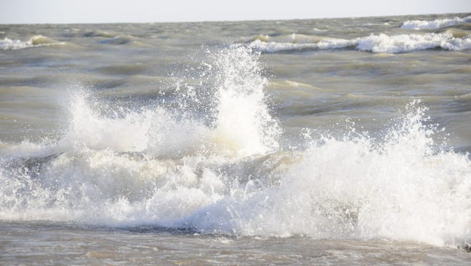 Waves driven by a strong northeast wind slam into the shoreline. Large waves could develop today.