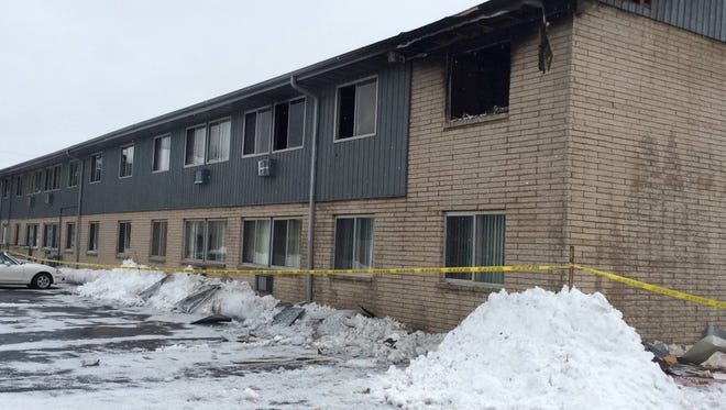 Fire in the apartment at the upper right caused smoke and other damage to this building at 1686 Shawano Ave., Green Bay.