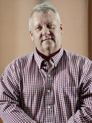 Green Bay City Council President Tom DeWane stands