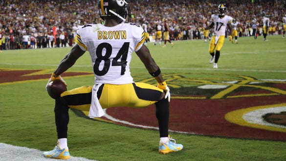 Antonio Brown twerks on the field after scoring a touchdown.