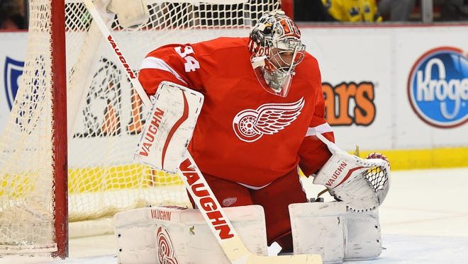 Detroit Red Wings goalie Petr Mrazek (34) makes a save against the San Jose Sharks during the second period at Joe Louis Arena.