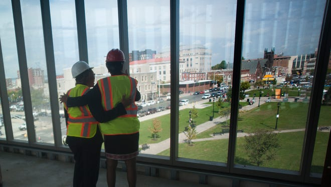 Mayor Dana Redd,  left, and Rutgers UniversityÐCamden Chancellor Phoebe Haddon embrace inside the ongoing construction of the new Rutgers-Camden Nursing and Science Building at 5th & Federal streets. The $62.5 million facility opening in the spring