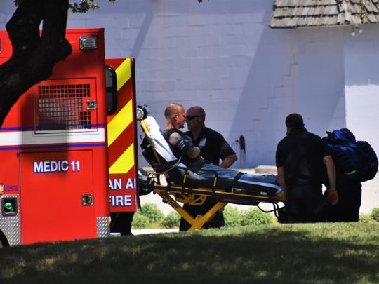 A man was loaded into an ambulance on August 6, 2018