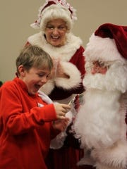 Santa and Mrs. Claus with Jacob Brown during the Goodyear