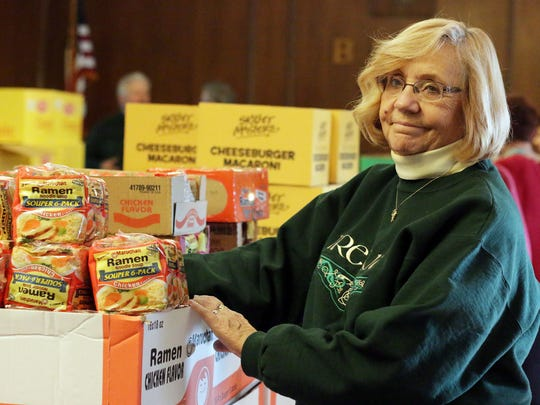 Sharon McCormick of Sheboygan waits by Ramen noodles to be placed in a box as part of a package for less fortunate Sheboygan families with the Elks Club's 12 Days of Christmas Saturday December 5, 2015 in Sheboygan.