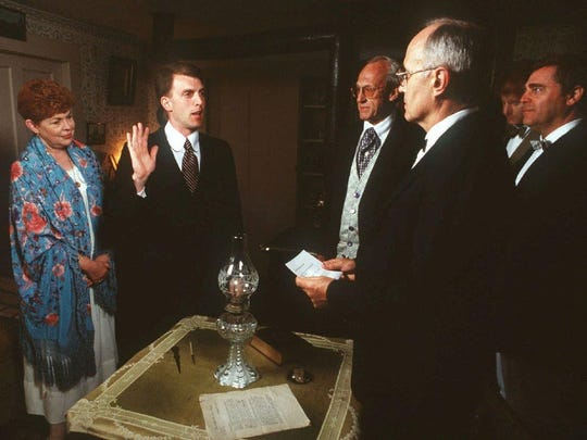 The Calvin Coolidge inauguration is reenacted at 1:47 a.m. Monday, Aug. 3, 1998, in Plymouth Notch. From left, Lydia Coolidge Sayles as Grace Coolidge; Christopher Coolidge Jeter as his great-grandfather Calvin Coolidge; Porter H. Dale as his grandfather Congressman Porter Dale; Jim Cooke as Col. John Coolidge; Eric Francis as reporter Joe Fountain; and William Jenney as Erwin Geisser, Calvin Coolidge aide.