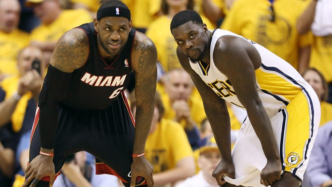 Heat forward LeBron James and Pacers guard Lance Stephenson stand on the court during the fourth quarter of Game 5.