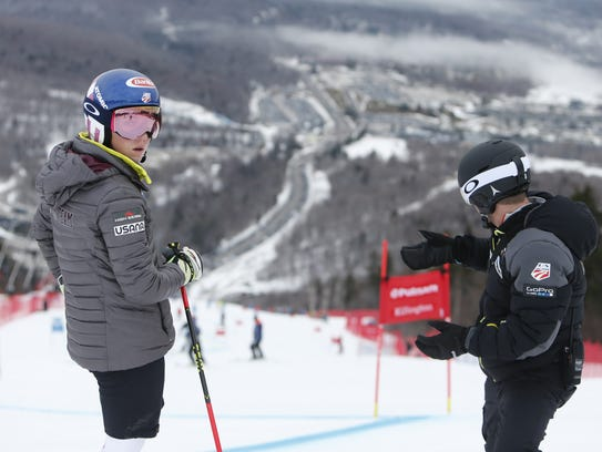 Mikaela Shiffrin of USA, with a coach during the inspection