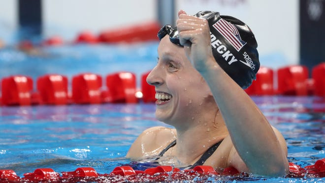 Katie Ledecky celebrates after winning the women's 800-meter freestyle.