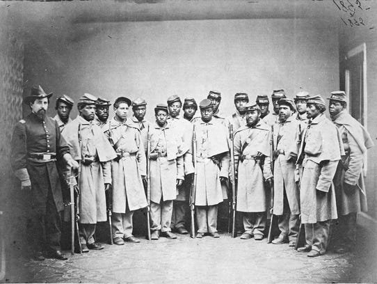 This photograph of African-American soldiers that were