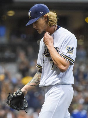 Milwaukee Brewers pitcher Josh Hader (71) walks back to the dugout after pitching the seventh inning against the Los Angeles Dodgers at Miller Park.