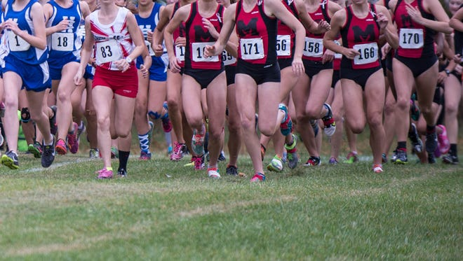 Marshall girls cross country runners during a 2015 race.