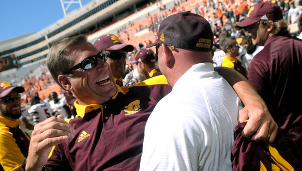 Central Michigan's Athletic Director Dave Heeke celebrates