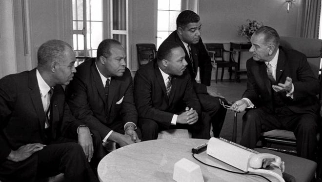 From left, Roy Wilkins, James Farmer, MLK, Whitney Young and President LBJ in a meeting at the White House in 1964.