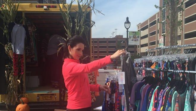 Rosina Miller, Mrs. Monroe County America, shops at the LulaRoe by E & K vendor during Roc'ella.