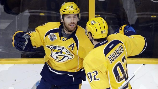 Predators left wing James Neal, left, celebrates with Ryan Johansen after Neal scored a goal against the Blue Jackets in the first period.